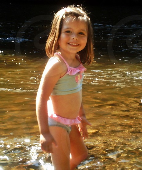 little girl in the river photo