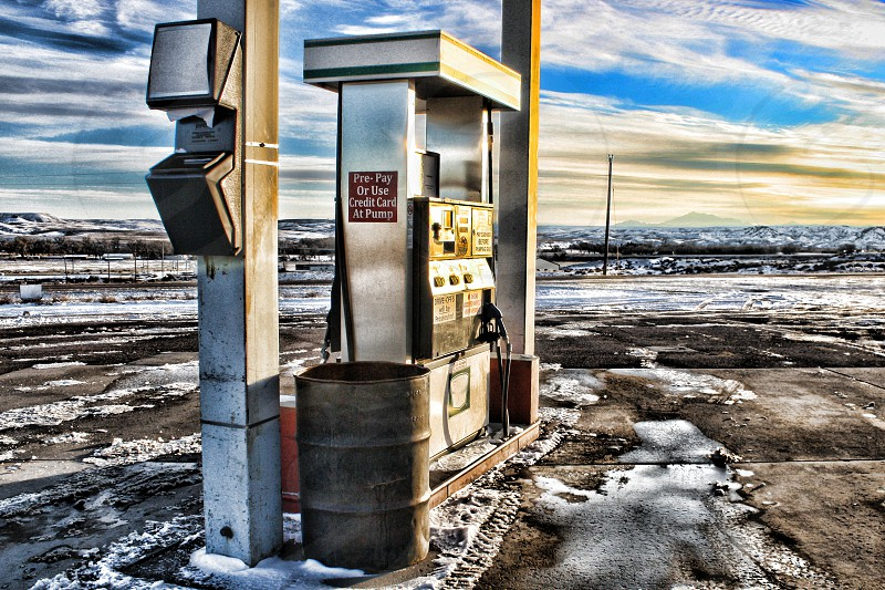 Isolated gas pump on an empty  icy road. photo