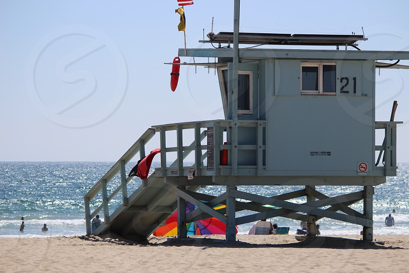 Beach lifeguard station sunbathing sunshine sand photo