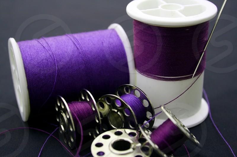 sewing thread needle spools bobbins photo