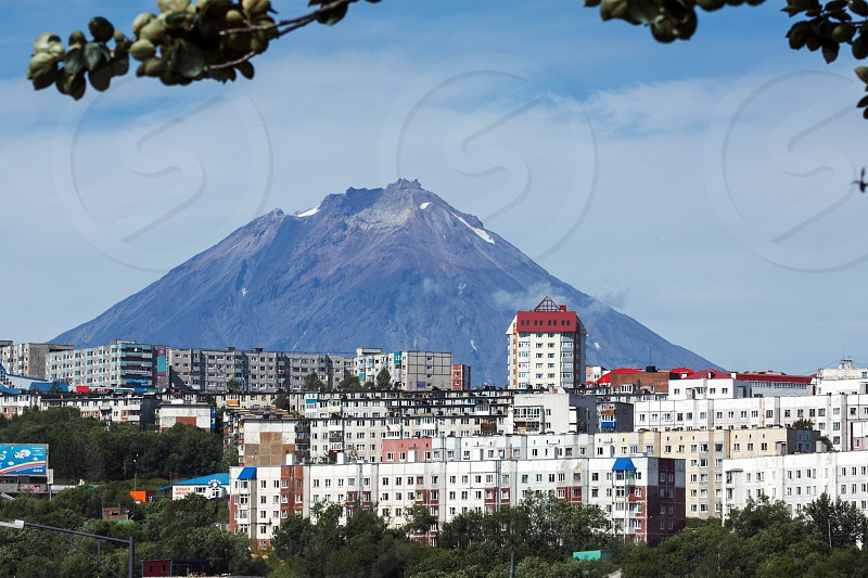 Summer cityscape: view of Petropavlovsk-Kamchatsky City and beautiful active Koryak Volcano on a sunny day. Russia Far East. photo
