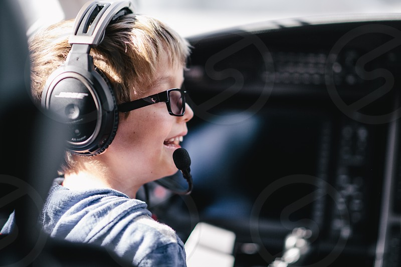 boy in eyeglasses and headset in shallow lens photo