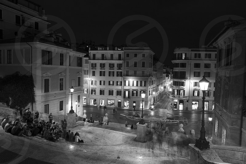 grayscale photography of white concrete house during nighttime photo