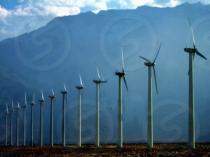 Long row of windmills near mountains in Palm Springs photo