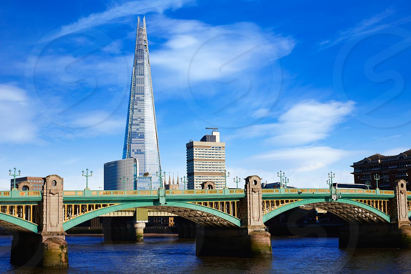 London Southwark bridge and the Shard on Thames river in UK photo