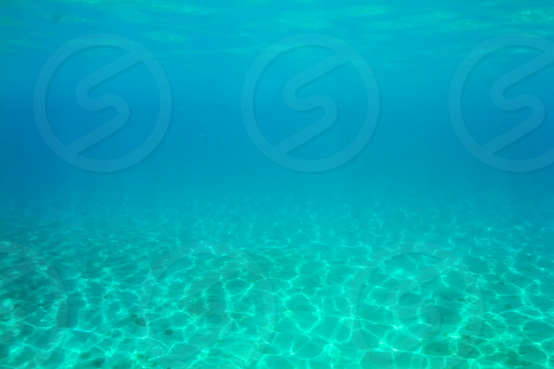 Underwater sunlight rays sun rays ocean bottom of ocean vast open devoid of life drowning sea photo