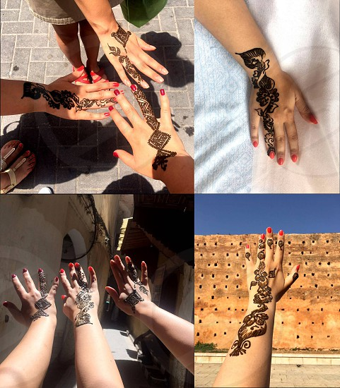 Unique henna patterns on the hands of young girls - friends. Morocco. photo