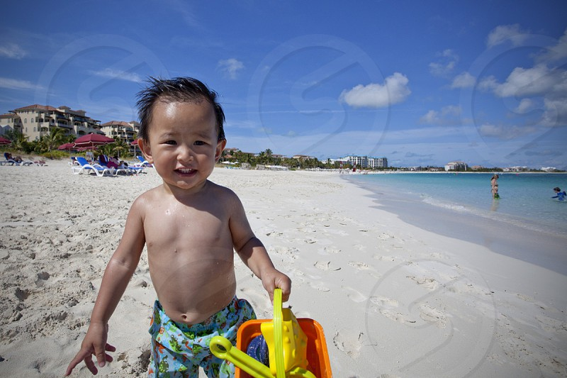 baby standing on sand photo