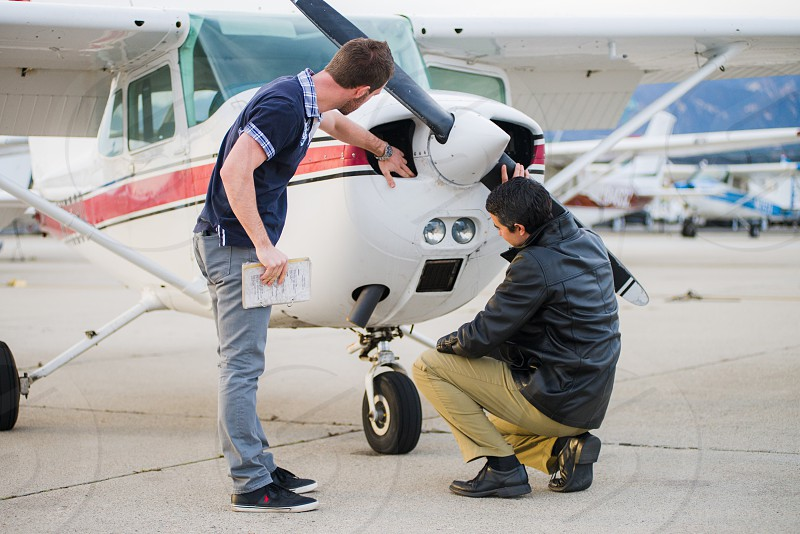 man checking on cessna propeller blade photo