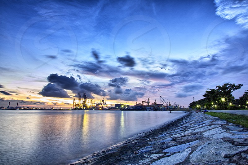 Sunset at West Coast Park Sunset Clouds Lights Sea Habour Park Shipyard Singapore West Coast Park Clementi West Asia Beautiful Long exposure Strolling Relaxing Travel Landscape  photo