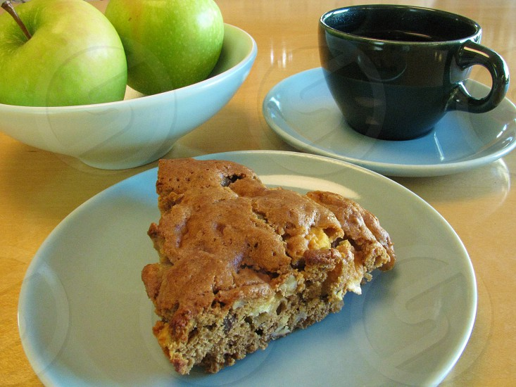 Snack break with chunky apple spice cake and fresh-brewed coffee.                  photo