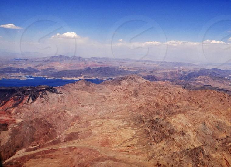 brown mountain range and blue skies photo