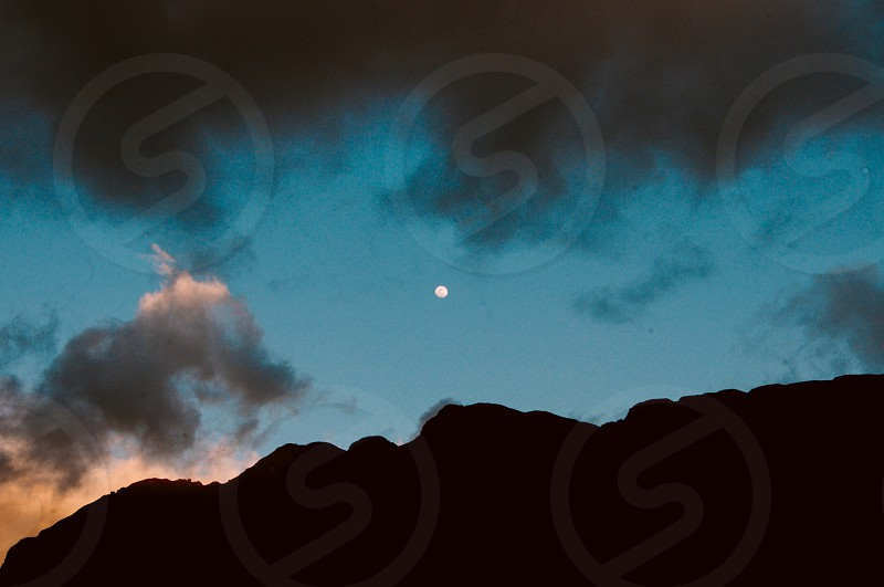 Can you see the face looking up at the night sky? photo