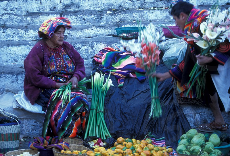 people in traditional clotes at the Market in the Village of  Chichi or Chichicastenango in Guatemala in central America.    photo