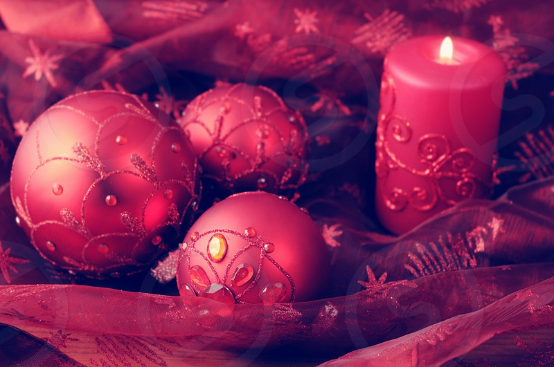 red Christmas balls with candles. Holiday photo