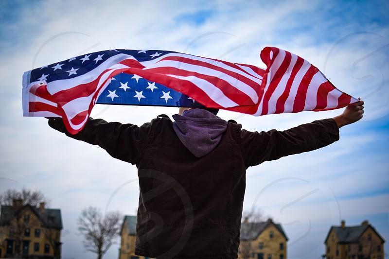 Boy waving flag photo
