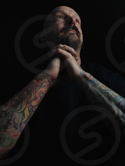 man in black t shirt with arm tattoos photo