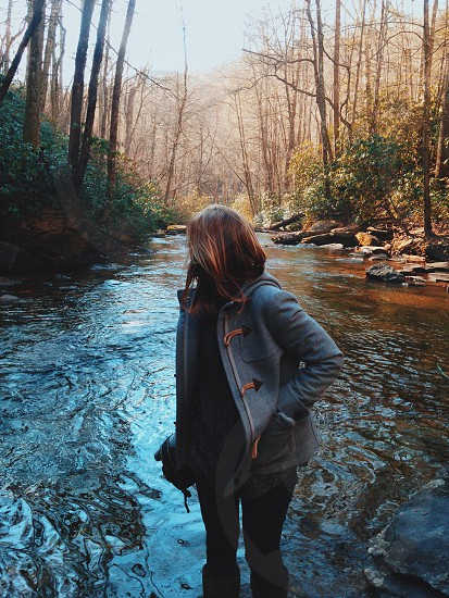 Forest river nature girl woman water trees looking back adventure photo