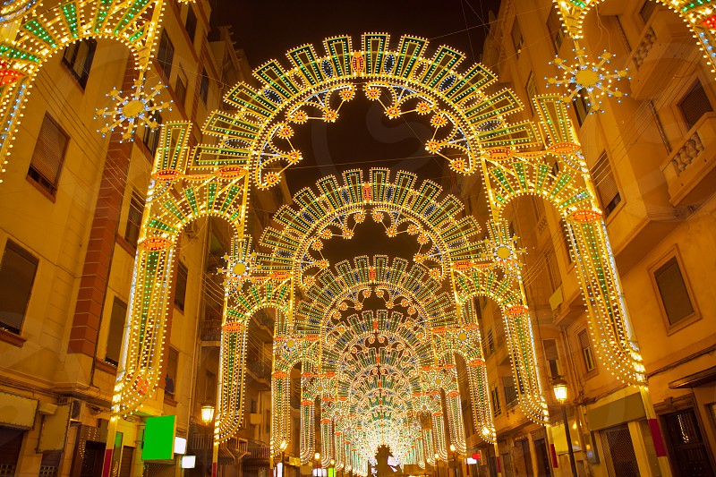 Beautiful night lights in Fallas fest of Valencia in calle Sueca street Spain photo