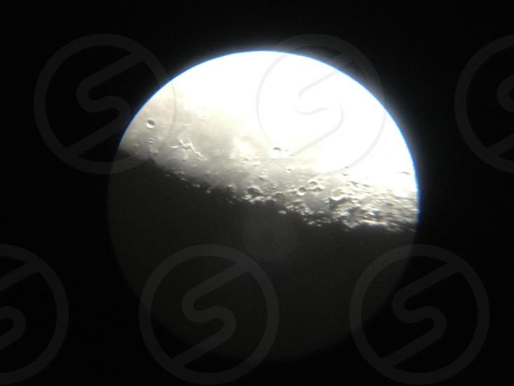 The moon seen through a telescope photo