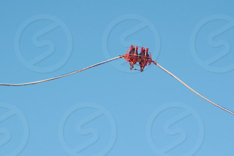 Theme Park Catapult Slingshot with Clear Blue Sky photo