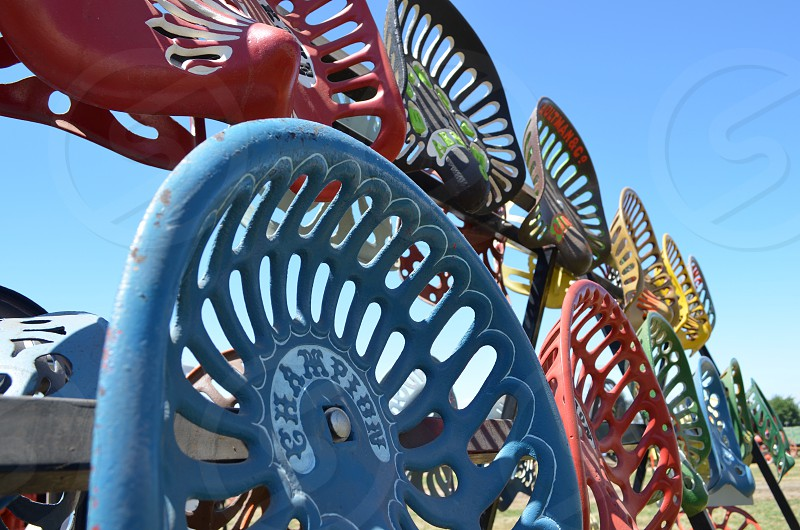 Colorful vintage tractor seats photo