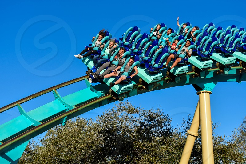 Orlando Florida . February 26  2019.  People enjoying terrific Kraken rollercoaster at Seaworld Theme Park (11) photo