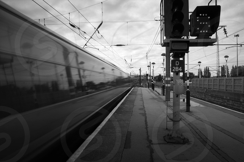 Fast moving train blurred by motion in monochrome.  photo