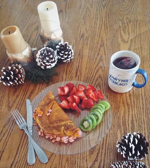 Food breakfast fruit omelet candles pine cones tea mug photo