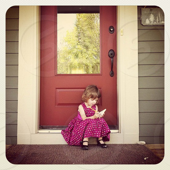 Toddler drawing on front porch photo