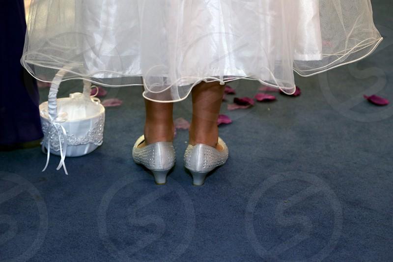 Wedding dress shoes petals photo