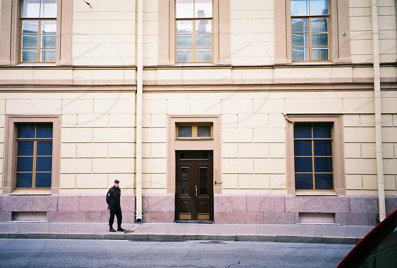 Policeman saint-Petersburg old building on patrol  photo