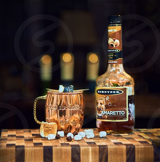 Hot chocolate with amaretto and toasted marshmallows in a copper mule cup. photo