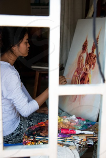 Young woman oil painting artist from Cambodia.   photo