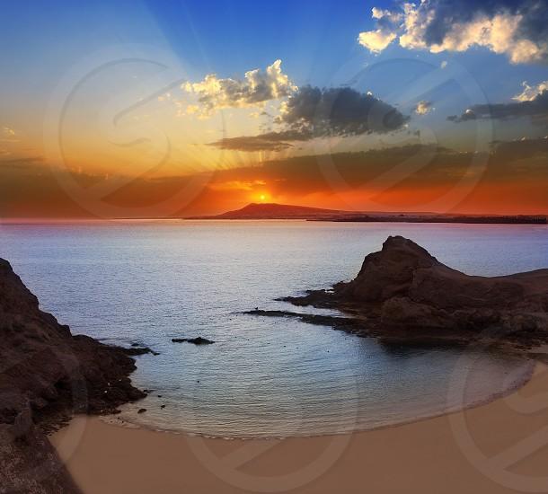 Lanzarote Playa Papagayo beach sunset in Canary islands photo