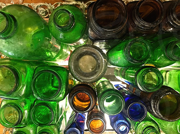 Seen from above  is a collection of vintage green glass bottles photo