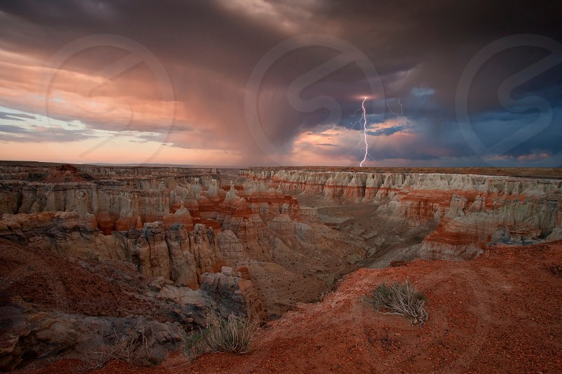 Lightning over colorful Coal  Mine Canyon Navajo reservation 3rd Mesa Arizona  photo