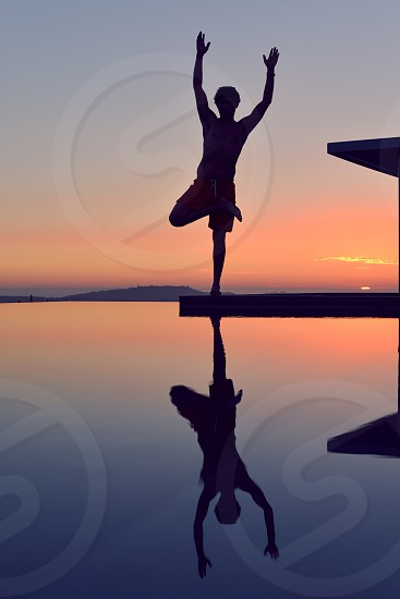 meditation summit peak sunset reflect man reflection water yoga photo