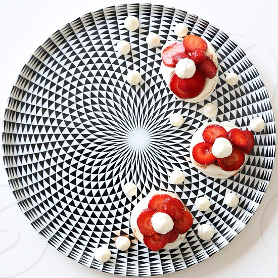 mini-pavlovas with strawberries macerated in pomegranate vinegar and honey  photo