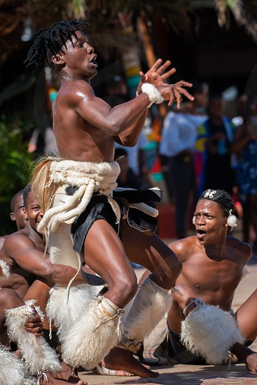 Zulu cultural dancers show off their passion and moves at the waterfront in Durban South Africa. photo