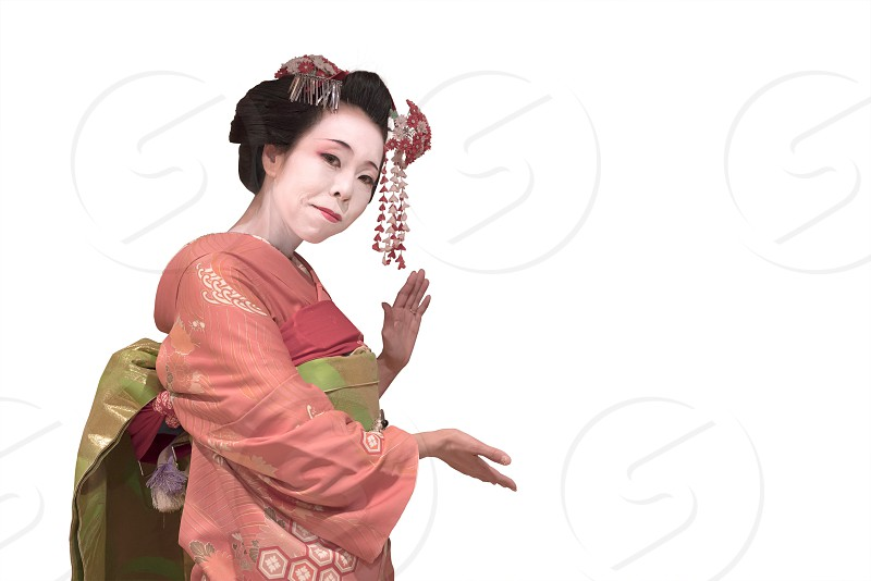 Clipping japanese geisha maiko girl in red kimono coifed hair brooch with patterns of red and white plum blossoms on white background. photo