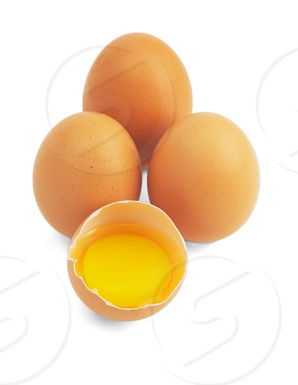 four eggsone open ;isolated on white background photo