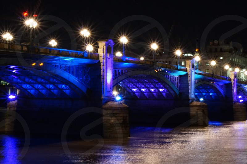 Bridge with colourful blue lights at night photo