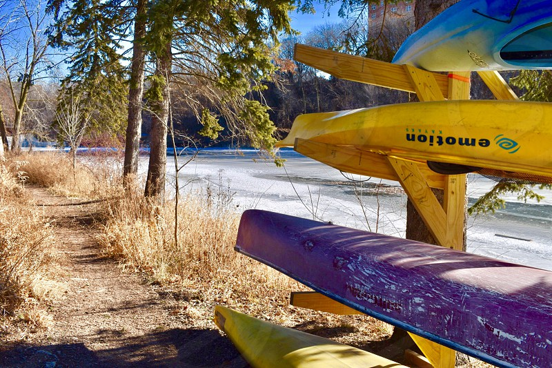 Kayak water sports winter adventure woods camping campground snow forest photo