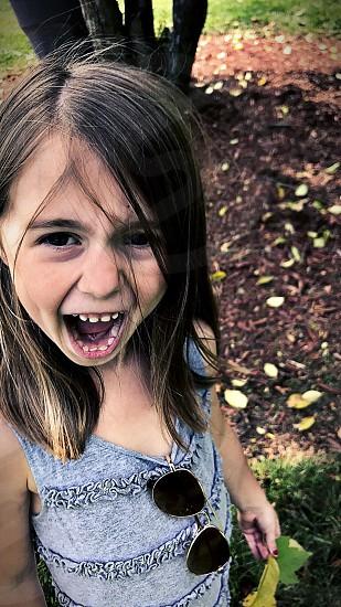 Child scary face fun goofy little girl photo