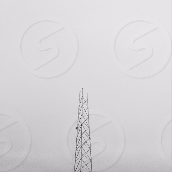 Symmetry negative space triangles tower fog grey skies communication   photo