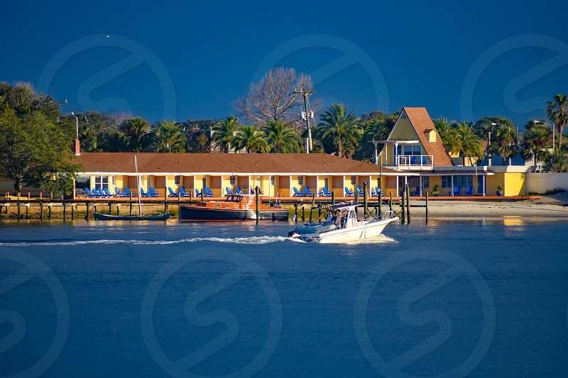 St. Augustine Florida. January 26  2019.  Sailboat and colorful motel on blue sky background in Florida's Historic Coast. photo