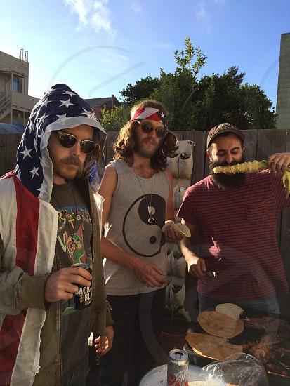 America red white and blue corn on the cob boys guys BBQ grill grill master beards photo