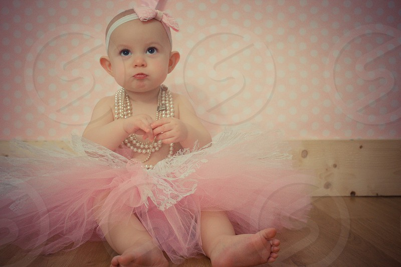 Baby girl in a pink tutu.  photo