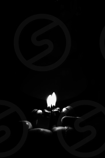grayscale photography of two ignited lighters photo